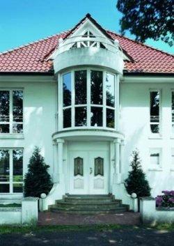 Dom wielorodzinny z oknami  Schüco PVC